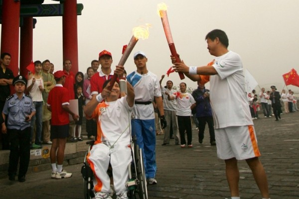 The kiss Between Beijing 2008 Paralympic Torches